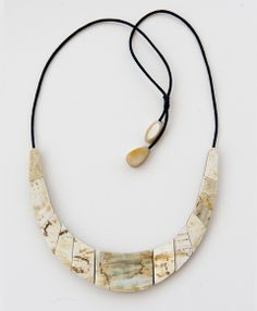 Exotic and unique, this necklace is composed of hand carved water buffalo horn and can be adjusted to the length you desire for a short collar look or a hanging statement piece.