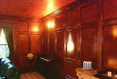 Floor to ceiling paneled walls. Birch and maple with red mahogany stain.