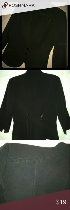 White House Black Market Trophy Blazer Classy  Black Trophy Blazer with  Ruffle trim on shoulder, neckline and lapels. Beautiful detail , two buttons in front and  eight  faux  buttons in the center on the back side.  In great condition, only worn 2 times  Shell 63% Polyester  32% Rayon  05% Spandex Lining  100 % Polyester  Dry Clean Only White House Black Market Jackets & Coats Blazers