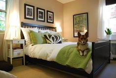 I like the way the bed is made, the photos above the bed and the framed picture next to the bed....and everything else
