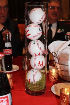 Personalized baseball centerpieces for a Fenway Park wedding. Baseball centerpieces.