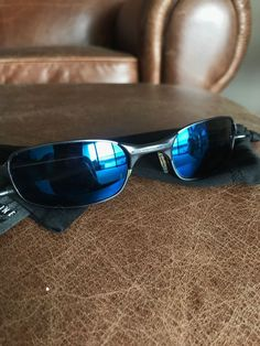 b4ff7e5e03 Oakley Mens Sunglasses Black Frames With Blue Lens  fashion  clothing   shoes  accessories