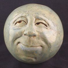Man in the Moon!   click on picture to see more of these wonderful garden heads on Etsy.