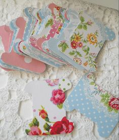 Brilliant idea- she glued wrapping paper to cardstock to make prettier embroidery floss cards!