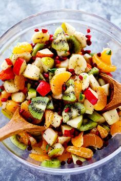 The Best Winter Fruit Salad is filled with clementines, kiwi, pears, apples, and pomegranate. It gets tossed in a delicious ...