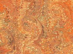 Marbled paper hand made by Laura Berretti of Florence, Italy, in a centuries old tradition. By the pictures on the website, I think she also colors actual marbles, along with beads, notepads, stationery and pens, and ceramic Christmas ornaments. (The website is in Italian, which I don't know.)