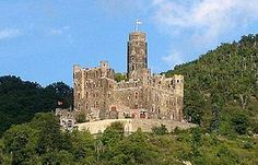 Maus Castle (German: Burg Maus, meaning Mouse Castle) is a castle above the village of Wellmich (part of Sankt Goarshausen) in Rhineland-Palatinate, Germany. It lies on the east side of the Rhine, north of Katz Castle (Cat Castle) in Sankt Goarshausen and opposite Rheinfels Castle at Sankt Goar across the river