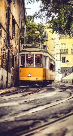 Lisbon Travel Guide: Spread across steep hills, Lisbon is a city brimming with culture, charm and beauty - perfect for a city break. Vogue's deputy editor Emily Sheffield shares her secrets to exploring the Portuguese capital in true Lisboan style. Lisbon Tram, Photo Voyage, Anime W, Spain And Portugal, Destinations, Belle Photo, Wonders Of The World, Travel Inspiration, Places To Visit