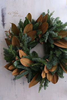 Mix magnolia leaves in with faux evergreen wreath. Silver Christmas Decorations, Christmas Greenery, Noel Christmas, Christmas Crafts, Holiday Decor, Magnolia Wreath, Magnolia Leaves, Corona Floral, Xmas Wreaths