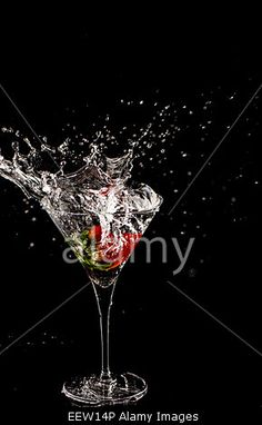 Download this stock image: Strawberry Martini Glass Splash - EEW14P from Alamy's library of millions of high resolution stock photos, Stock Photo, illustrations and vectors.