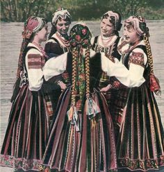 Polish Women in folk costume from Podlasie (Poland). (But their hair's fake, unfortunately.)