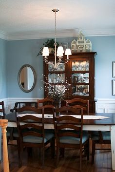 This is perfect for you. Same dark furniture but light walls. Blue dining room - Valspar Seaside Villa paint.