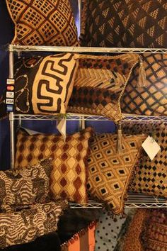 A display of one of a kind Kuba Cloth Pillows: My name is Bettye Carter and along with Michelle Edmonds we started Pillow Talk by Whispers over four years ago.    Pillow Talk by Whispers offers Luxury,