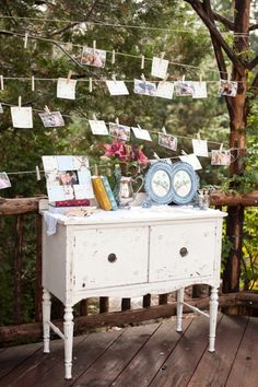 An adorable way to showcase engagement and relationship photos at the wedding. And a great place to have a guestbook!