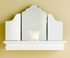 Shelf and Mirror Lighting        Maximize a small lamp's wattage by using mirrors to bounce the light around the room. Drill holes through the top and back of a shelf to accommodate a glass shade and lighting kit; guide the wiring out the back. Hang the shelf, then top with a folding mirror.