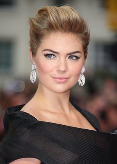 Classic swept back updo on Kate Upton - very Marilyn Monroe
