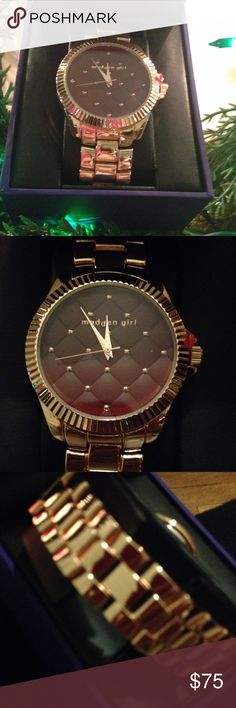 Watch Beautiful brass toned watch with quilted-like deep brown face with delicate detail. Perfect for the woman who likes a bolder style. Boxed and ready to gift. New, never worn!!!! Madden Girl Accessories Watches