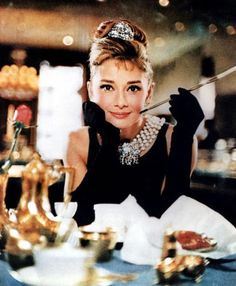 Audrey Hepburn in Breakfast at Tiffany's (1961): Famous Smoking Movie Characters - Movies like to glamorize all kinds of activities, including making smoking into a cool pastime.