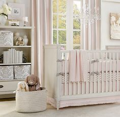 beautiful nursery... love the chandelier above the crib