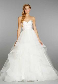 Hayley Paige ivory strapless natural waist bridal ball gown with silk radzmir crossover bodice, full tulle skirt with horsehair flounces and chapel train.