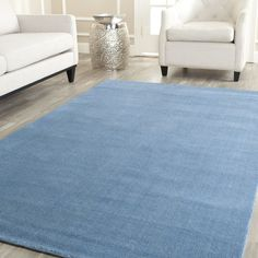Blue rug softens the floor, Safavieh Handmade Safavieh 'Himalayan Solo' Turquoise Blue Wool Rug Wool Area Rugs, Wool Rug, Turquoise Rug, Purple Area Rugs, Unique Rugs, Online Home Decor Stores, Colorful Rugs, Modern Decor, Modern Rugs