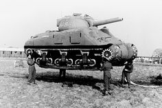 Members of The Ghost Army carrying one of their inflatable tanks.