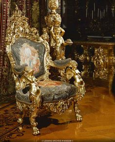 "NEO-BAROQUE INTERIORS:PALACES 19TH   Dollmann,Georg von  Gilded armchair in the king's study in Herrenchiemsee, a residence built for Ludwig II of Bavaria, who admired France's Louis XIV and saw himself as another ""sun-king"". Construction of Herrenchiemsee began after Ludwig's visit to Versailles in 1867.   Palace, Herrenchiemsee, Germany"