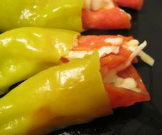 Stuffed pepperoncini...we use proscuttio and asiago cheese. They are delish.