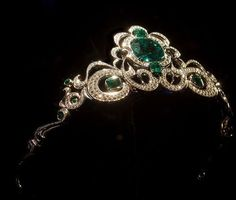 Platinum Tiara --  Emerald, platinum and diamond tiara, in Lester and Sue Smith Gem Vault. Located in Houston Museum of Natural Science. Cullen Hall of Gems and Minerals section.  Designer: Ernesto Moreira