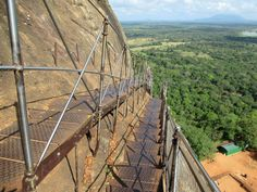 Visitors to Sigiriya Lion Rock in central Sri Lanka must climb a narrow stairway on the north side of the cliff.