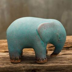 Shaped of ceramic, this sleek figurine represents an elephants grace. Duangkamol works in the painstaking celadon technique, creating a beautiful symbol of old Siam. It is glazed in a deep, rich turquoise with brown undertones. Ceramic Elephant, Elephant Art, Wild Elephant, Elephant Parade, Elephant Family, Asian Elephant, Pottery Animals, Ceramic Animals, Clay Animals