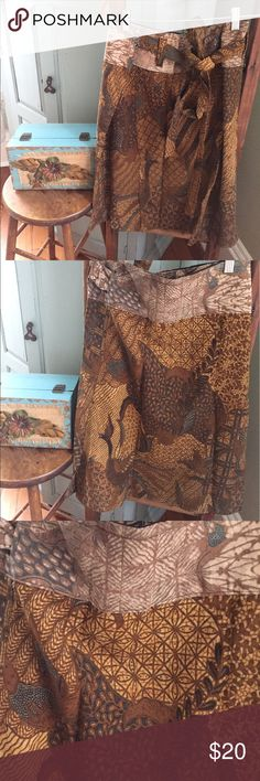 "Boho Tribal Wrap Around Skirt This skirt I only wore once but it's a great mustard, brown, cream, grey multi colored yumminess.😁I am listing it as s/m because they ran small and I believe this one stated XL. It measures 25""long and opened up about 50"" wide. Skirts"