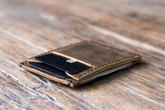 This handmade leather minimalist wallet is the wallet youve been looking for!!  Super slim design. As minimalist as it possibly gets while still being fully functional.  >>> Customize it >>> We also offer the option to add initials, a name, logo or even a quote to your custom made wallet.  On one side of the wallet, you have two horizontal slots, one for cards, the other for folded cash.  On the reverse side, you one vertical card slot, with an additional quick card access slot…