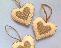 Handmade felt and burlap hearts set of 3 cut out of white felt and red burlap fabric. These pretty hearts measure inches wide by inches high with a inches high jute string to hang. Thanks for visiting my shop Vintage Ornaments, Felt Ornaments, Christmas Tree Ornaments, Valentine Heart, Valentine Crafts, Fabric Hearts, Christmas Hearts, Burlap Fabric, Felt Hearts