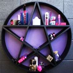 Amazing Handmade Pentagram shelf! Great for displaying your favourite trinkets, mystical goodies, potions & skulls. Measurements: 60cm wide x 60cm high x 10cm deep  Hanging: There is a metal triangle hanger on the back of the shelf, which can be hung off a hook or nail. The shelf is heavy so please make sure your hook or nails is secured strongly in the wall. Materials: Made from MDF and hand painted with wood paint. PLEASE NOTE : Due to the size & weight this can only be sent to Australian…