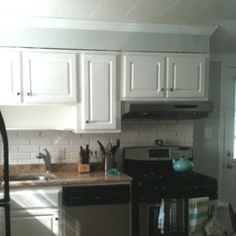 Finished cabinets using Rustoleum Cabinet Transformations. Not too shabby.