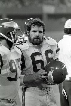 Linebacker Bill Bergey #66 of the Philadelphia Eagles looks on from the sideline while standing next to linebacker John Bunting #95 during a preseason game against the Pittsburgh Steelers at Three Rivers Stadium on September 2, 1977 in Pittsburgh, Pennsylvania