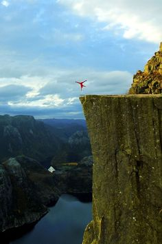 The first one-arm handstand on Earth to be performed at nearly 2000 feet above a fjord