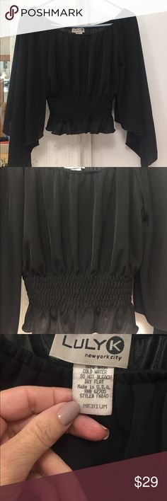 Beautiful blk top 🌺!!!! Beautiful blk top -  flowy sleeves , elastic waist - might fit cropped fit - kinda short round neck - never worn just sitting in closet -new condition🌸- 82% poly - 15% nylon - 3% Lycra luly k Tops Crop Tops