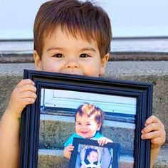 This shows a picture of Redditor noobprodigys little man when he turned two — holding a picture of himself at one, holding a picture of himself as an infant.