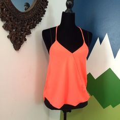 Cute coral top Worn but in great shape no rips stains or tears two overlapping parts in the front and one in the back cute straps please bundle for a better price! Tops Tank Tops