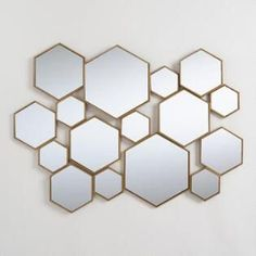 Cost Plus World Market Brass Metal Hexagon Mirror Panel Why We Love It Make a grand statement with our contemporary panel featuring a cluster of brass hexagon-shaped mirrors in an array of sizes and depths for added dimension. Vintage Wall Art, Vintage Walls, Unique Picture Frames, Mirror Panels, Floor Mirrors, Mirror Mirror, Mirror Above Couch, Entryway Mirror, Mirror Wall Art