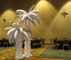 Balloon Sculptures palm tree | white and silver palm frond palm trees on white trunks