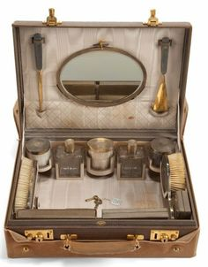 A French cosmetics set circa 1920, perhaps the sorts of items that would be found in Pip's room.