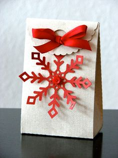 cute Christmas gift bag - love the red button in the middle of the red snowflake