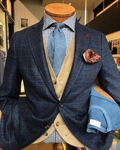 Navy plaid jacket, tan waistcoat, light blue necktie