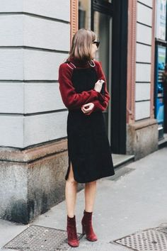 Winter outfit: burgundy turtleneck sweater, black dress, burgundy booties