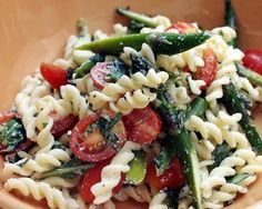 Pasta salad is fantastic on a hot, summer day. This seasonal recipe comes together fairly quickly and can serve a small crowd. The crunch of raw asparagus, the sweetness of summer tomatoes, and the peppery fragrance of basil combine to make a satisfying, delicious appetizer or side dish. See all tomato recipes.