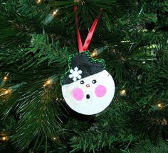 Hey, I found this really awesome Etsy listing at http://www.etsy.com/listing/116823932/snowman-sanddollar-christmas-ornament