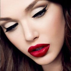 Dark eyes, brown hair and red-coloured lips is a perfect match.